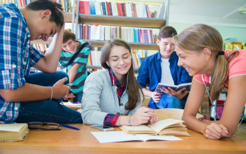 Group of students studying in the library