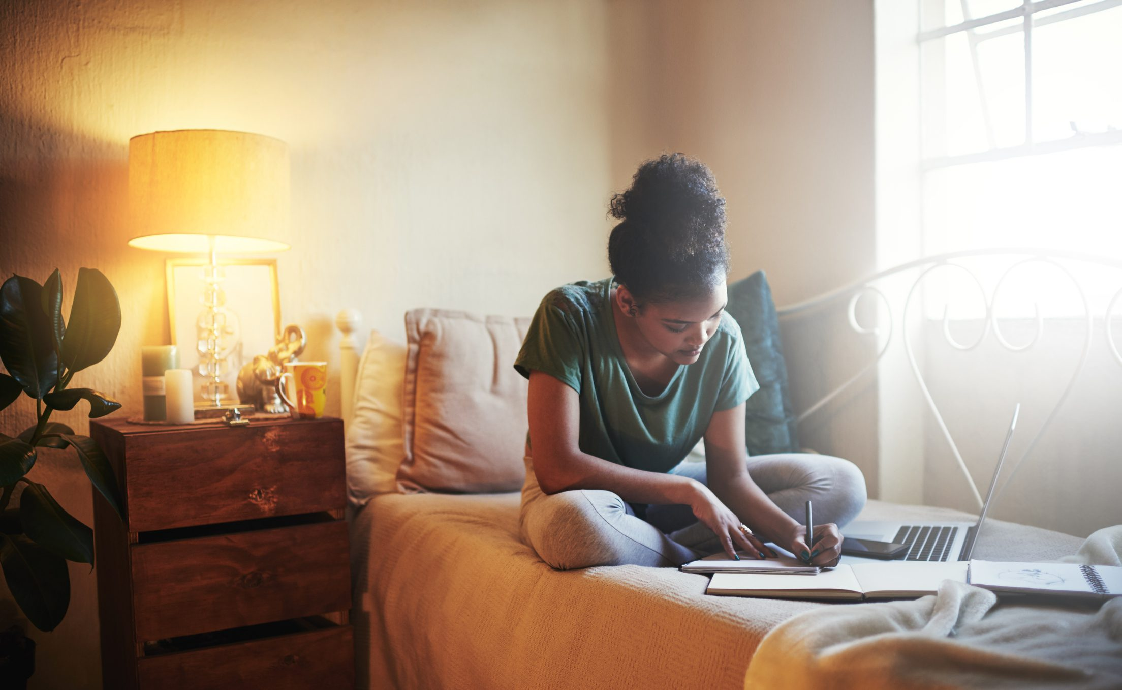 young female student studying at home