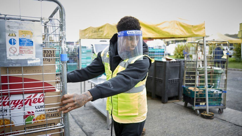 Marcus Rashford in PPE equipment working at food bank