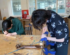 Students do a woodwork workshop